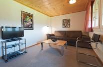 Wohnzimmer mit Doppelbettsofa